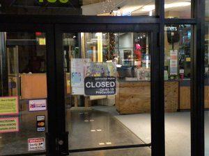 Sign says 'closed - COVID-19 precaution'