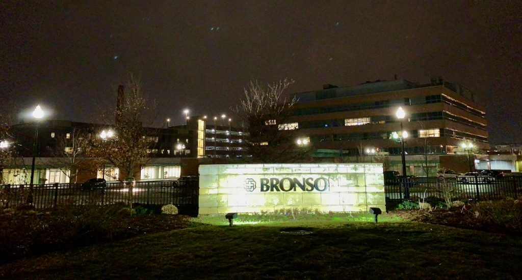Bronson Hospital sign lit up at night