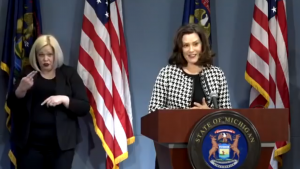 Governor Gretchen Whitmer behind a podium.