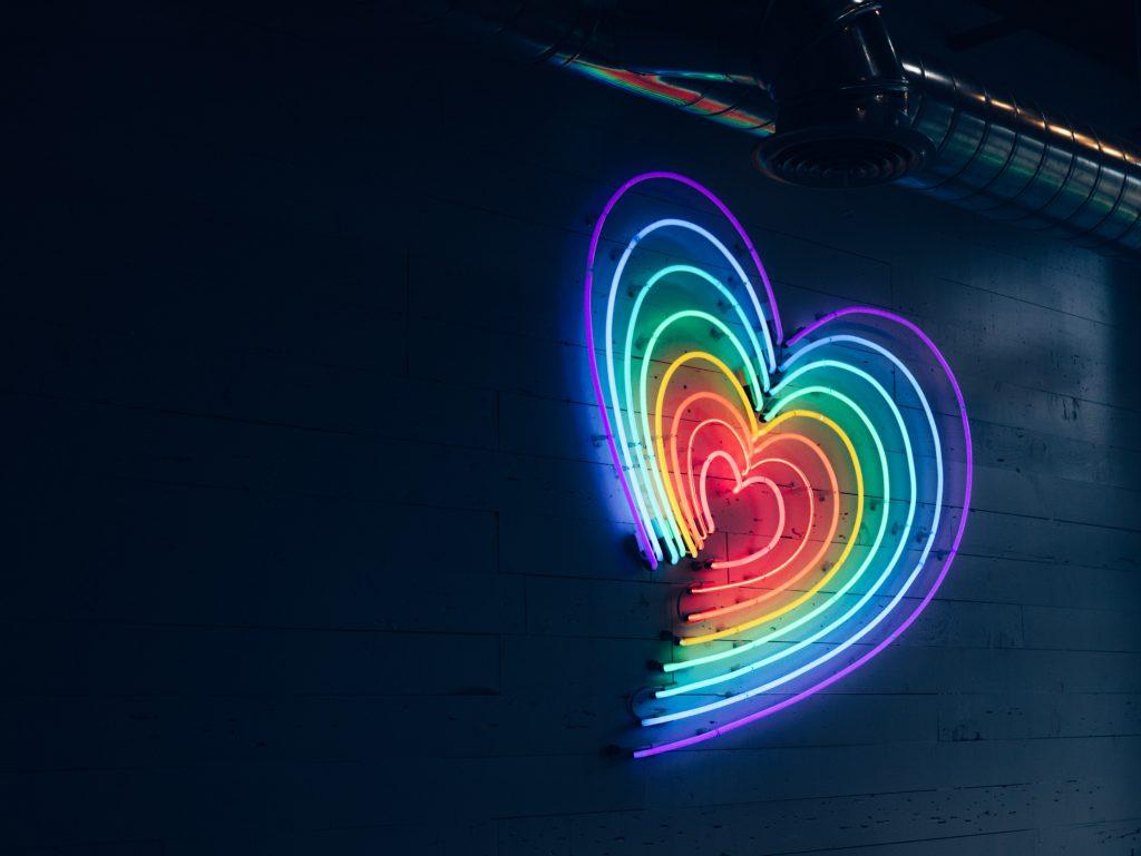 A neon rainbow heart
