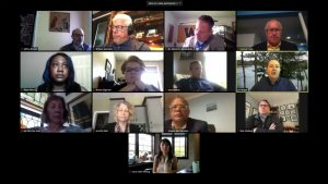 A group of 13 people in an online meeting.