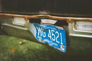 a beat up Michigan license plate