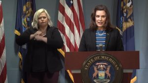 Governor Gretchen Whitmer standing behind a podium