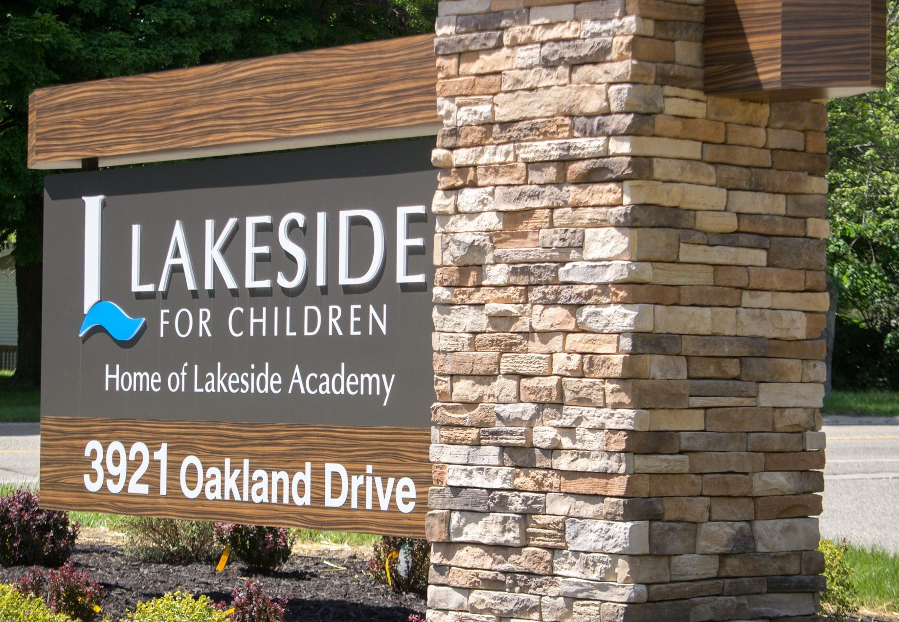 "a sign that reads ""Lakeside for Children - Home of Lakeside Academy"""