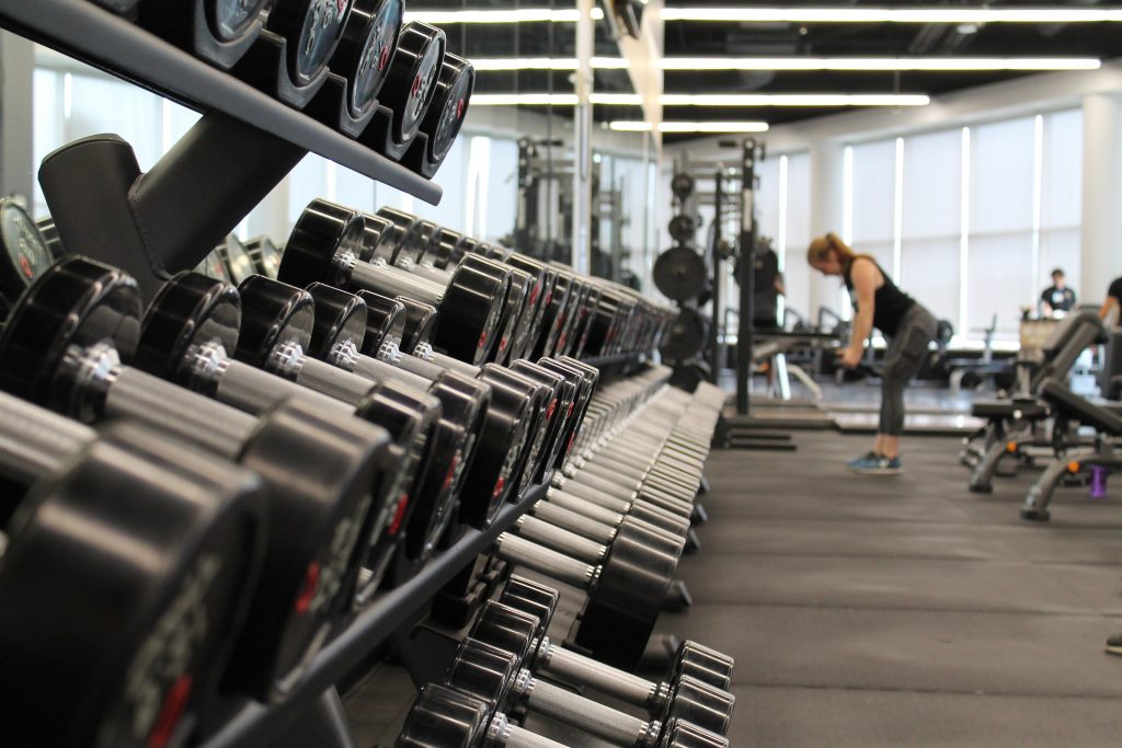 a woman lifts weights in a gym