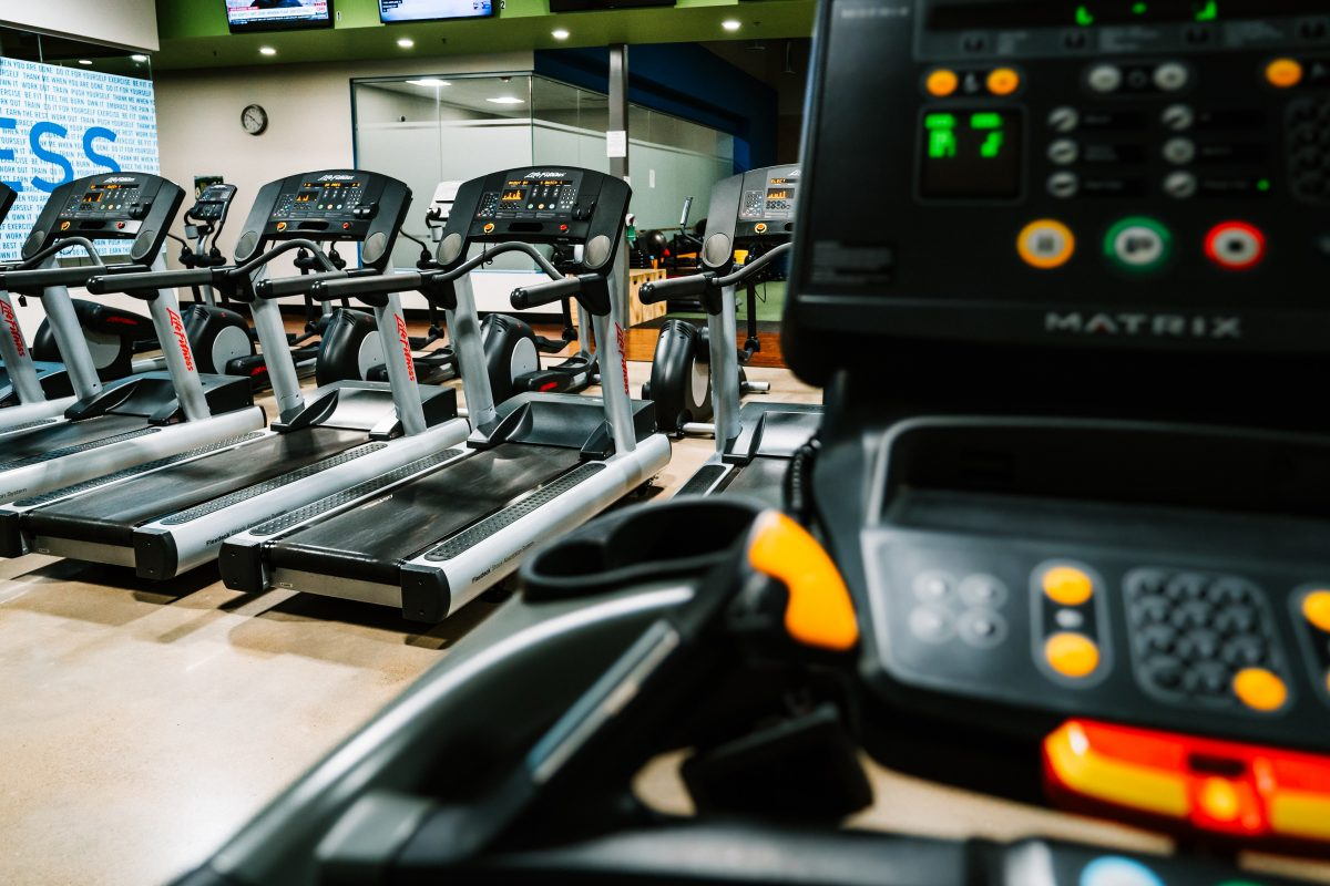 a row of empty treadmills