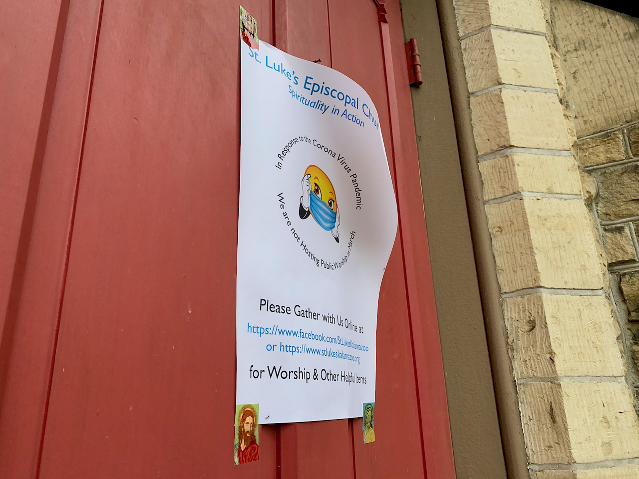 a sign on the door of a church announcing online church services