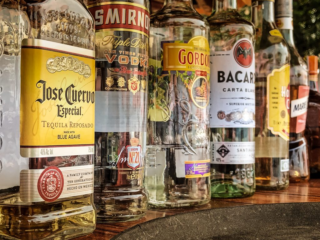 several partially-filled liquor bottles