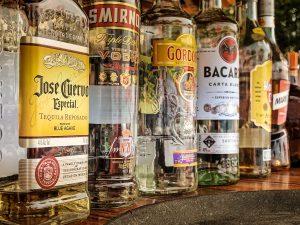 several partially-filled liquor bottles