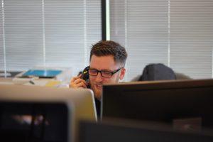 a man talks on the phone