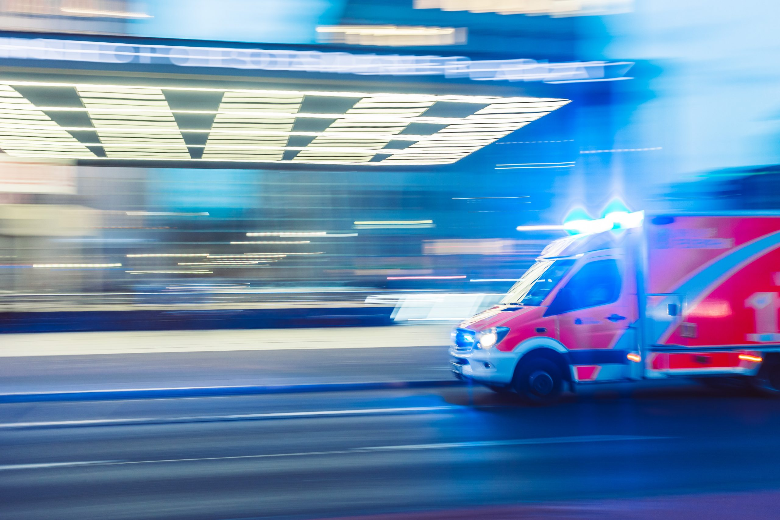 an ambulance races down the road