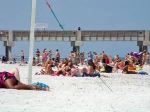 a crowd of people on a beach