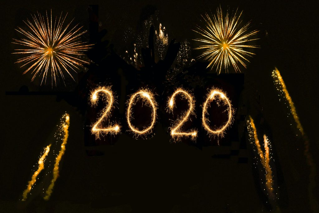 "fireworks explode around the word ""2020"""