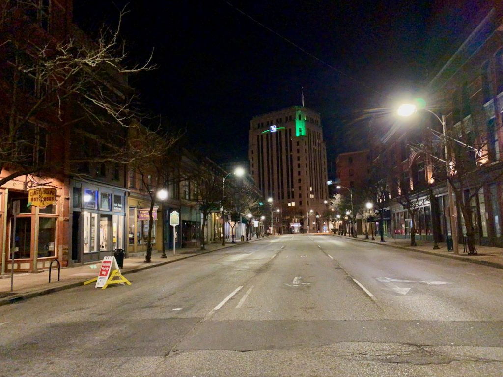 a downtown street, usually busy, is completely empty