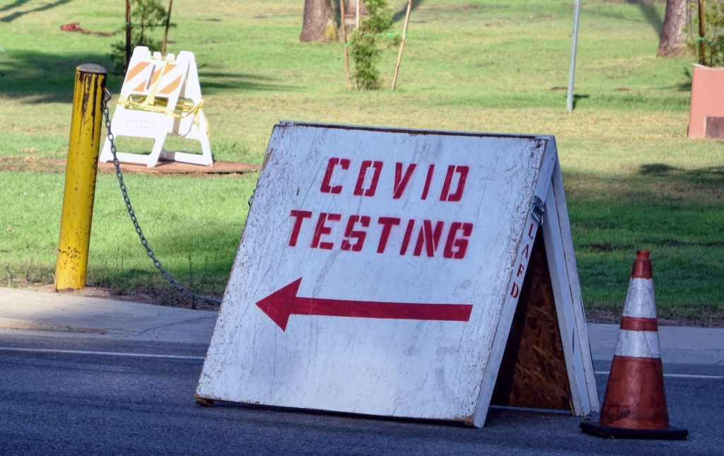 """a sign that reads """"COVID testing"""""""