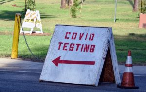 "a sign that reads ""COVID testing"""