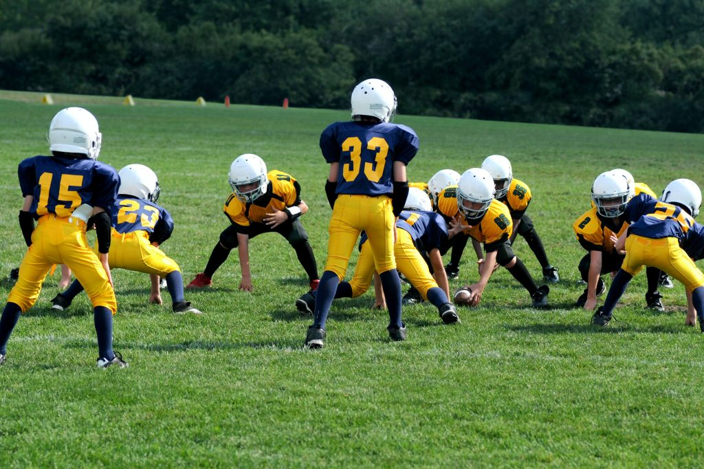 a group of high schoolers play football