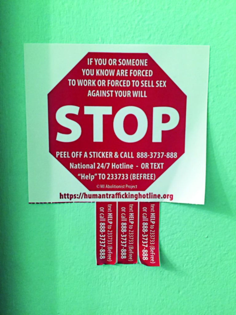 """A """"stop-sign"""" advertizes a phone number for stopping sex trafficking."""
