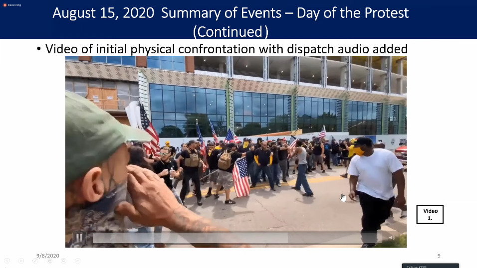 """a man yells toward a group of people in a video. a headline reads """"video of initial physical confrontation with dispatch audio added."""