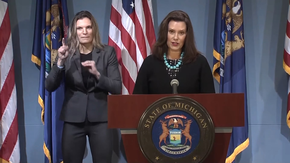 Governor Whitmer and a sign-language interpreter during a press conference.