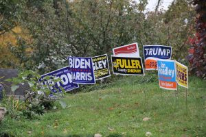 a collection of political yard signs.