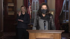 Governor Gretchen Whitmer and a sign language interpreter