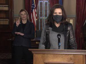 Governor Gretchen Whitmer and a sign language interpreter
