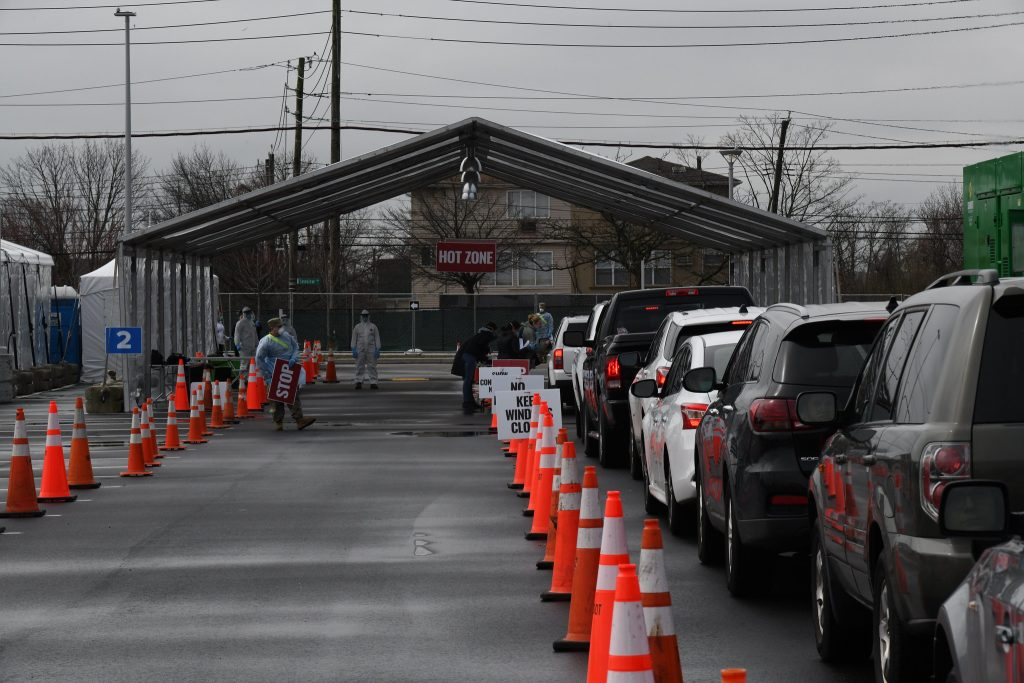 a line of cars outside a COVID testing center