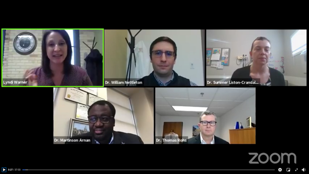 A group of medical professionals in a Zoom meeting.