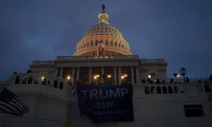 A Trump 2020 flag hangs over a balcony at the US Capitol