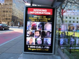 a sign asking for information about U.S. Capitol attackers