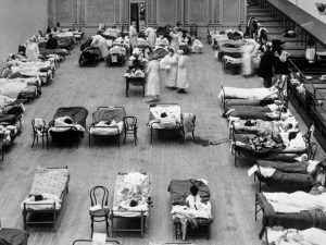 a black-and-white photo of a hospital ward during the 1918 flu pandemic