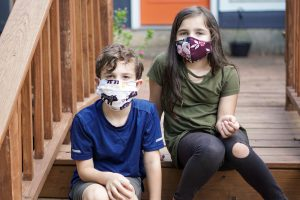 two children in face masks