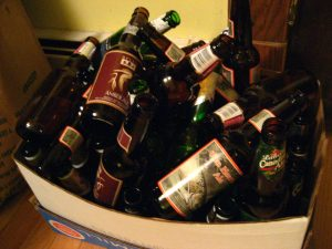 a box full of empty beer bottles
