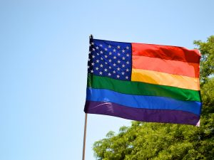 a U.S. flag with lgbtq+ pride colors