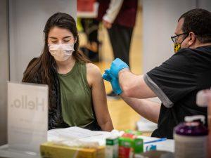 a woman receives a COVID vaccine