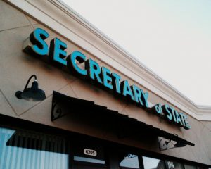 "a sign reading ""Secretary of State"""