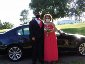 prom dates in tux and gown wearing COVID masks