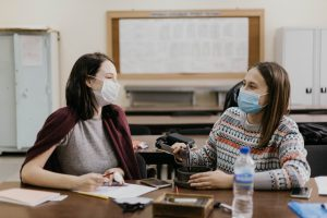 two high school students wearing face masks