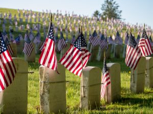U.S. flags on headstones in a cemetery