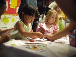 Children make a crafts project at a daycare