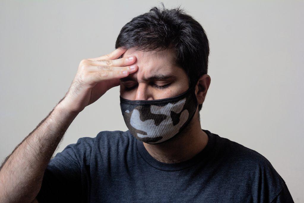 a man with a headache
