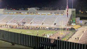 Students play football in WMU's Waldo Stadium