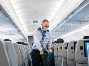 a flight attendant wearing a face mask