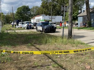 police tape stretched across a field